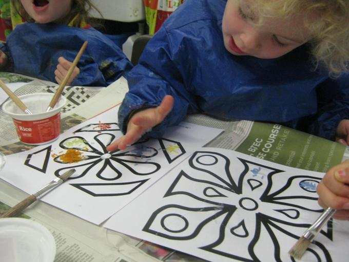 We decorated rangoli patterns with rice