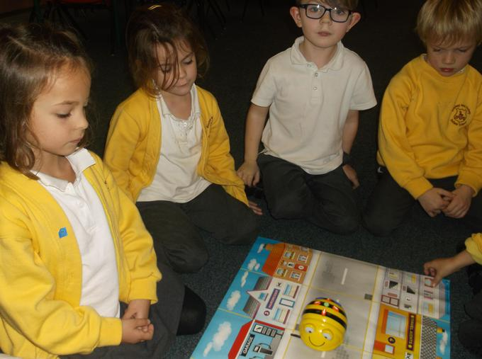 Working with friends to program a beebot