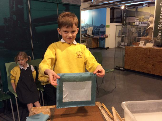 Proudly showing off our paper making skills