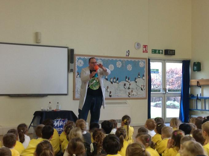Enjoying an assembly with 'Mad Science'