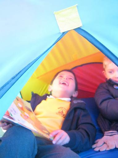 Enjoying sharing stories in tent