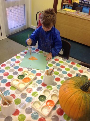 We have been painting pumpkins