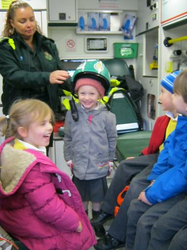 Everyone is keen to try on the hat!