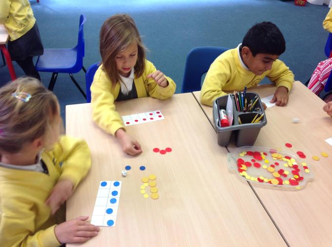 Practising our number bonds with a dice game