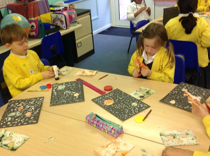 Using the paper we had marbled to cut out planets
