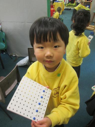 Making patterns with peg boards