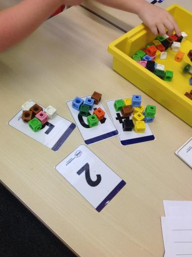 Matching cubes to the number cards
