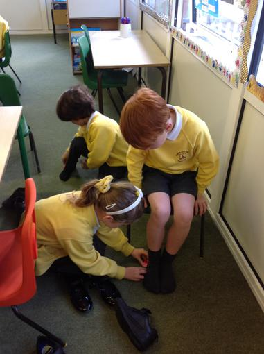 Drawing around our feet to measure them