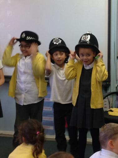Trying on a variety of police hats!