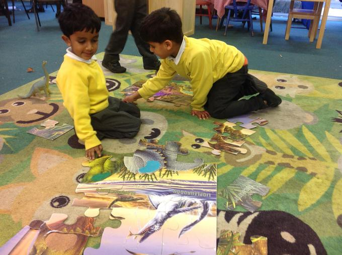 Completing a dinosaur puzzle