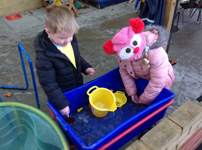 Working  to get the toys out of the ice