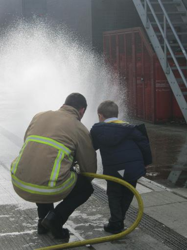 We enjoyed spraying water with the hose