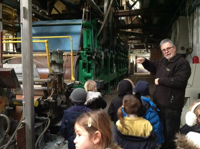 Showing the children round the paper mill