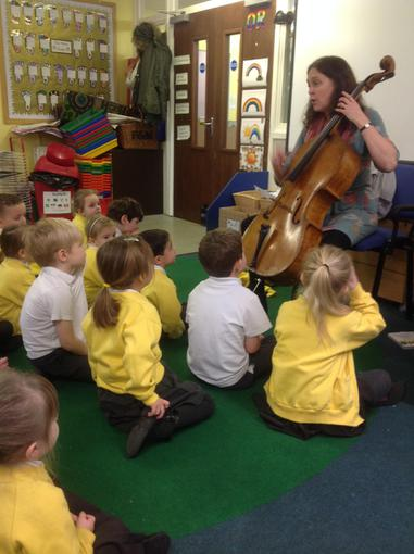 Dinosaur themed music lesson with a cello