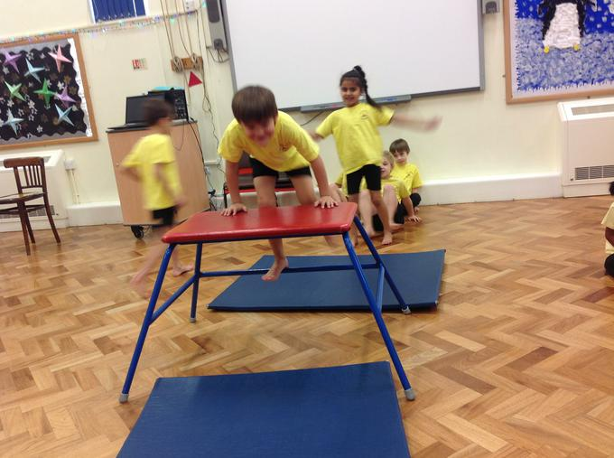Practising going over and under in PE