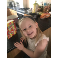 Emilia enjoying baking cupcakes!