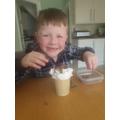 Lachlan enjoying a yummy hot chocolate!