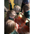 We enjoyed feeling and playing with red slimy jelly!