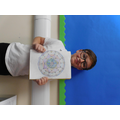 Micheal is proud of his symmetrical Mandala art.