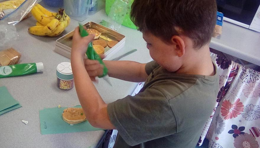 Using fine motor skills to decorate our Welsh cake