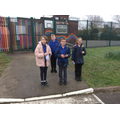 Learning to cross the road safely on the school si