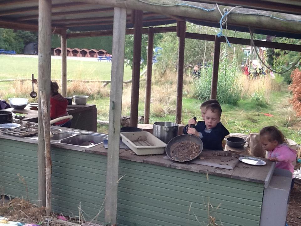 Cooking up something yummy in our mud kitchen!