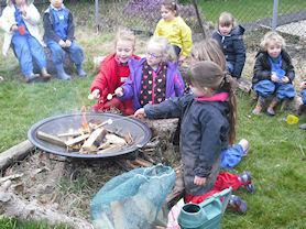 Toasting marshmallows on the fire