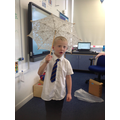 Lincoln modelling a parasol.