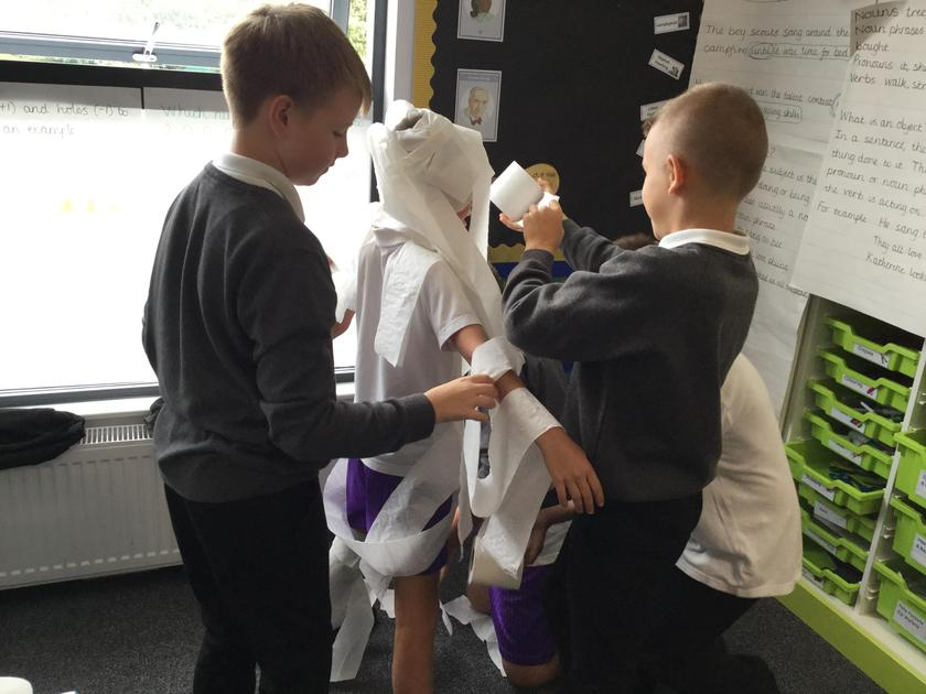 We worked as a team to mummify our friends.