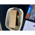 The cardboard box floated.