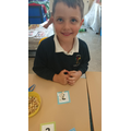 Counting out the correct number of beans.