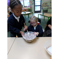 Stirring the biscuit mixture
