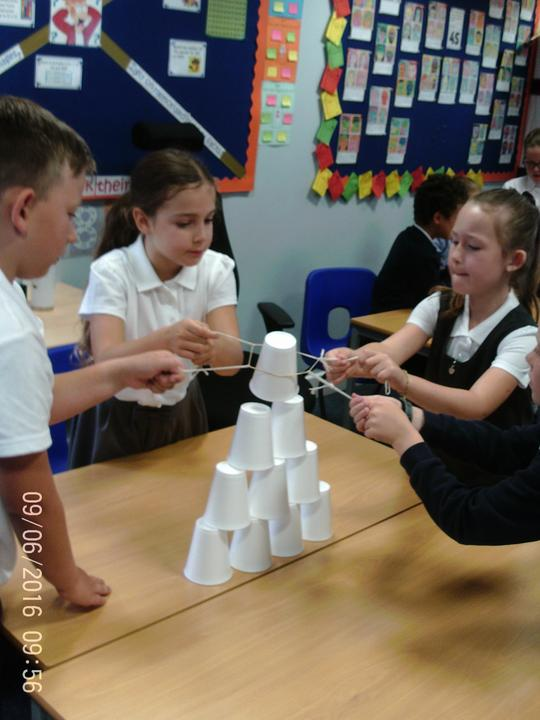 String, cups and elastic band = pyramid building!