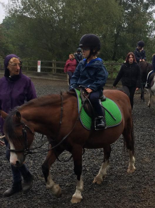 Horse riding at Green Meadow.