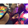 Put the numbers on the light box - Sensory play