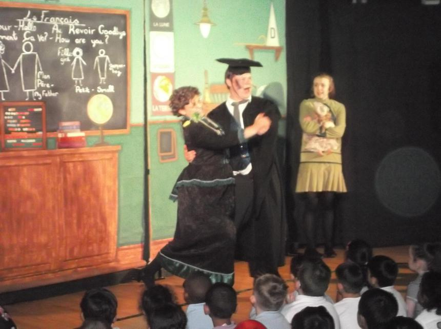 The French teacher charming the Headmistress.
