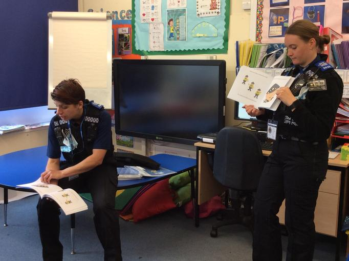 The two officers spoke with all the children in each classroom.