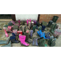 A selection of muddy boots outside a classroom.