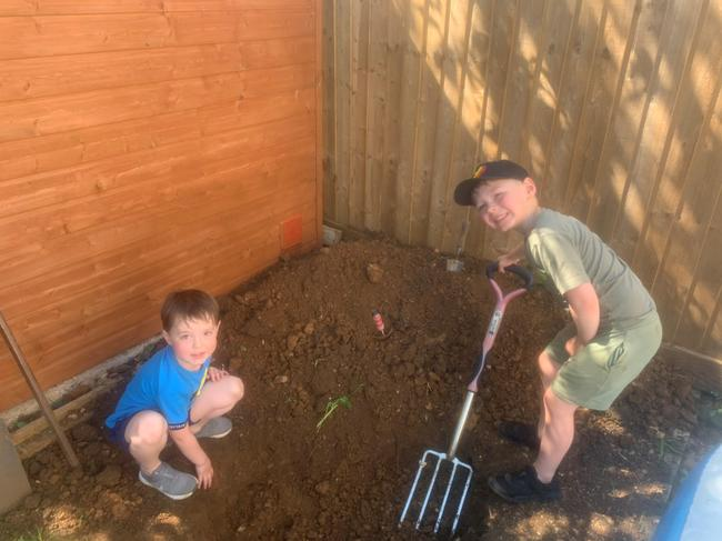 Helping Dad to dig a pond