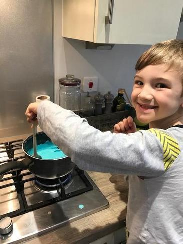 Making his own playdough.