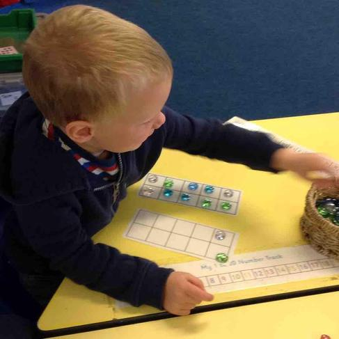 Making teen numbers using a tens frame