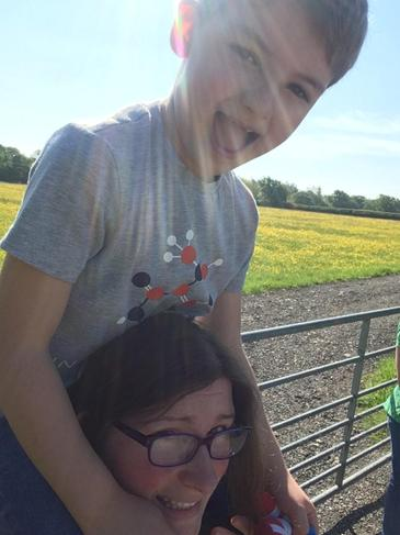 Time for a ride on mum's shoulders