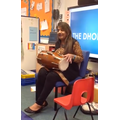 A Grandparent playing the Dhol drum