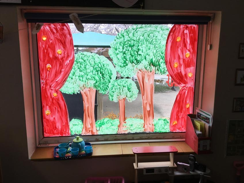 A window painted like a forest.