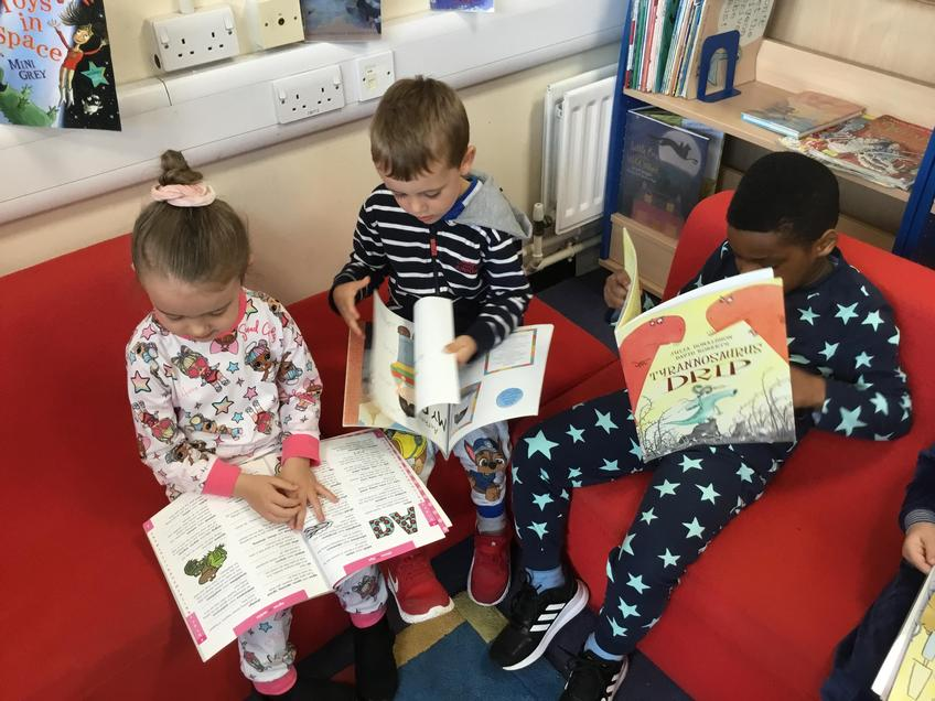 3 children reading a book each in a library.