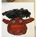 A child's painted portrait.