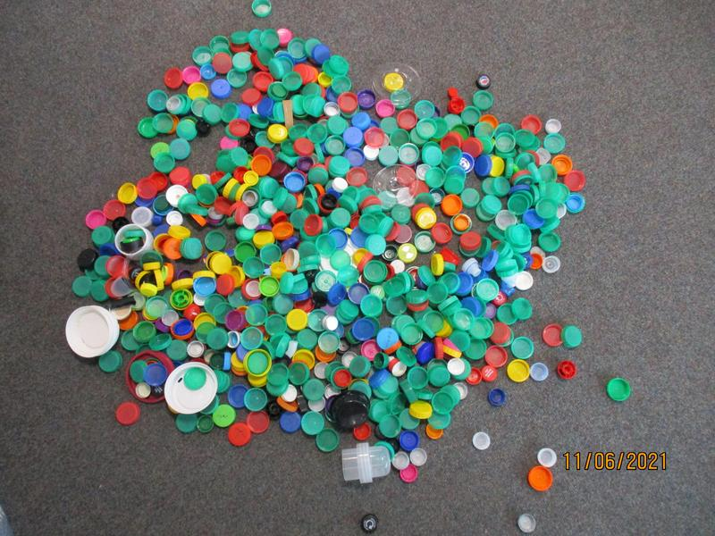 Can you estimate how many plastic bottle tops we collected?