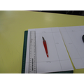Using a sharp tool, cut out the centre rectangle. A ruler helps keep you in line.