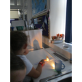 Investigating shadow size in science.