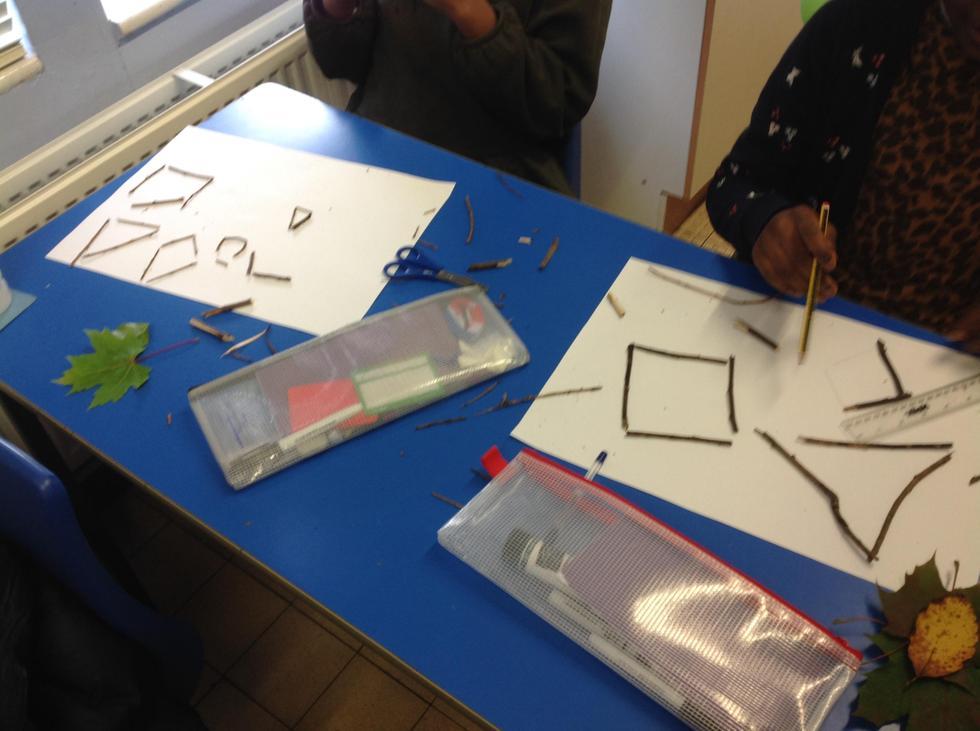 Kiyana and Joanna have made angles as well as shapes.